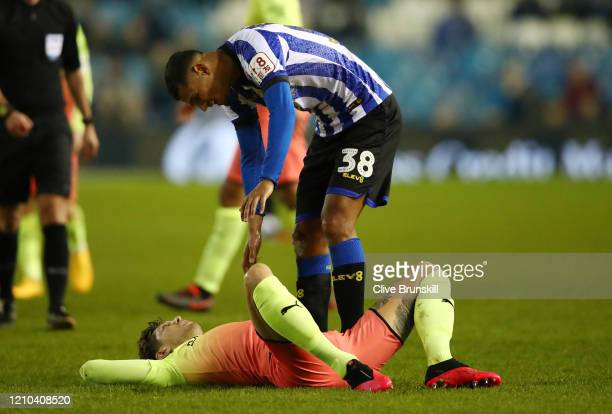 Alessio Da Cruz of Sheffield Wednesday checks on John Stones of Manchester City during the FA Cup Fifth Round match between Sheffield Wednesday and...