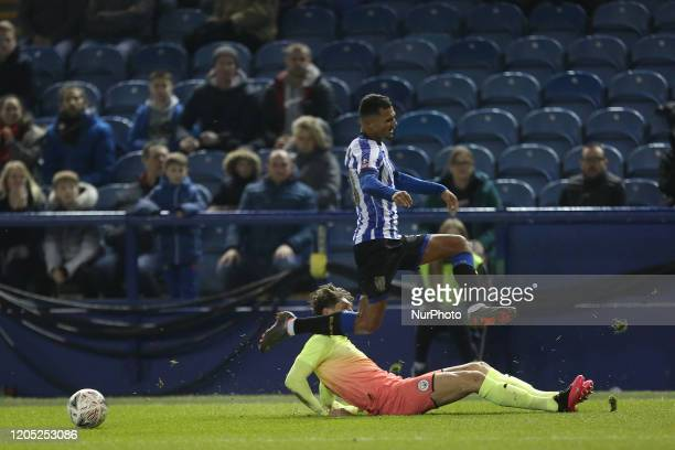 Alessio da Cruz of Sheffield Wednesday in action with John Stones of Manchester City during the FA Cup Fifth Road match between Sheffield Wednesday...