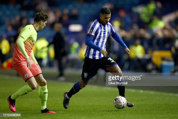 Alessio Da Cruz of Sheffield Wednesday runs with the ball under pressure from John Stones of Manchester City during the FA Cup Fifth Round match...