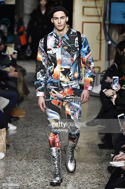 Alessio Pozzi walks the runway at the Moschino Autumn Winter 2017 fashion show during Milan Menswear Fashion Week on January 14 2017 in Milan Italy