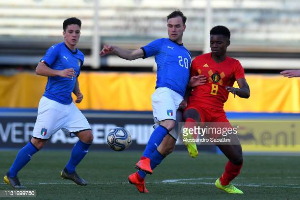 Alessio Riccardi of Italy U19 competes for the ball with Keres Masangu of Belgium U19 during the UEFA Elite Round match between Italy U19 and Belgium...