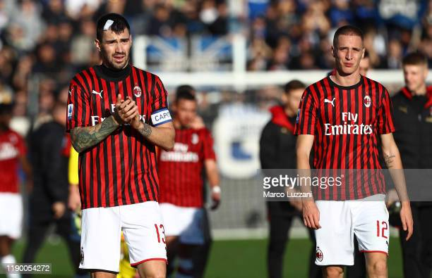 Alessio Romagnoli and Andrea Conti of AC Milan react after losing the Serie A match between Atalanta BC and AC Milan at Gewiss Stadium on December 22...