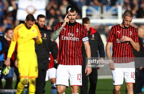 Alessio Romagnoli and Andrea Conti of AC Milan react after losing the Serie A match between Atalanta BC and AC Milan at Gewiss Stadium on December...