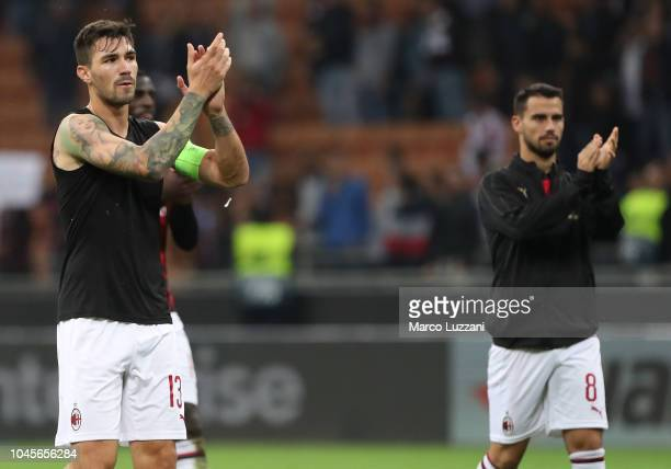 Alessio Romagnoli and Fernandez Suso of AC Milan celebrate a victory at the end of the UEFA Europa League Group F match between AC Milan and...