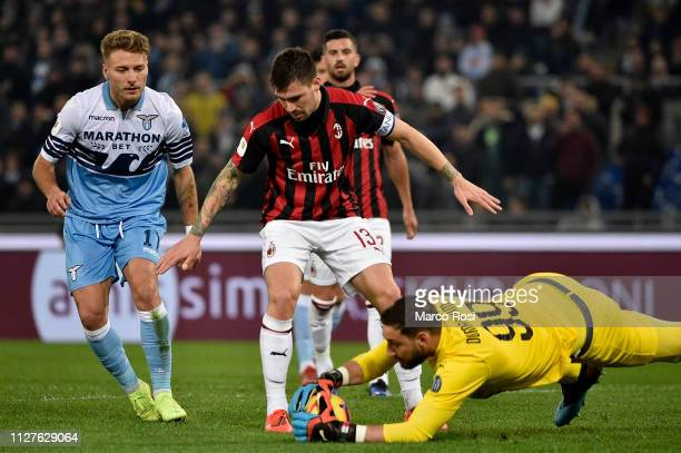 Alessio Romagnoli and Gigi Donnarumma of AC Milan during the Coppa Italia semifinal first leg between SS Lazio and AC Milan on February 26 2019 in...
