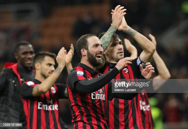 Alessio Romagnoli and Gonzalo Higuain of AC Milan celebrate a victory at the end of the serie A match between AC Milan and Genoa CFC at Stadio...