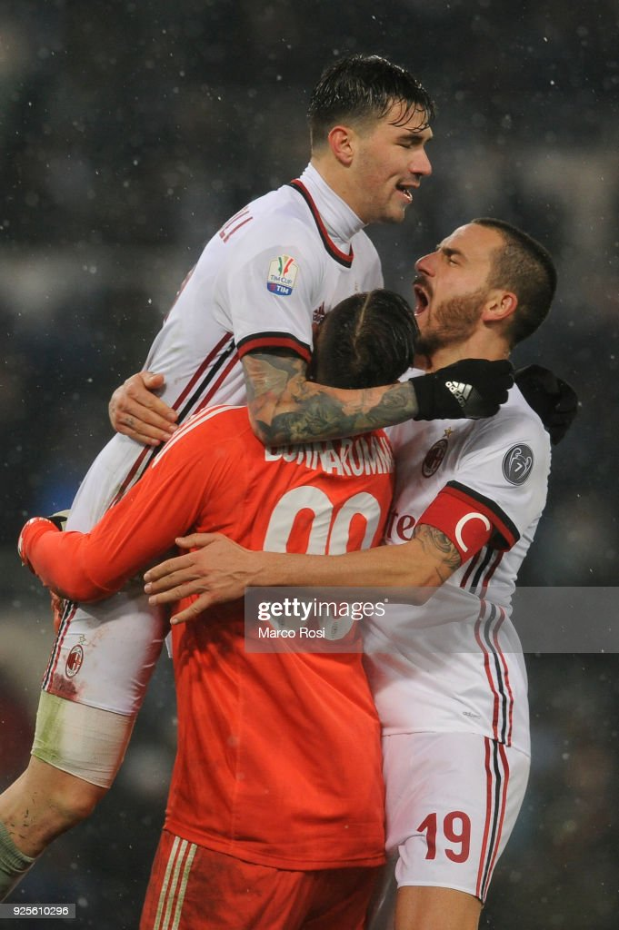 Alessio Romagnoli, Gialuigi Donnariumma and Leonardo Bonucci of AC Milan celebrates a winner game a penalty after the TIM Cup match between SS Lazio and AC Milan at Olimpico Stadium on February 28, 2018 in Rome, Italy.