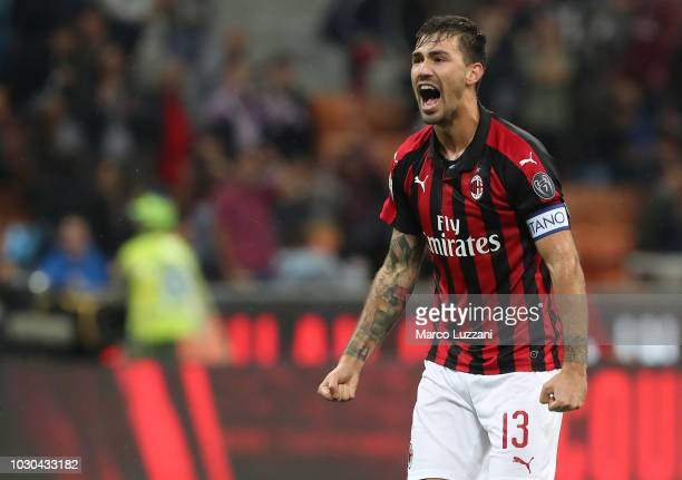 Alessio Romagnoli of AC Milan celebrates a victory at the end of the serie A match between AC Milan and AS Roma at Stadio Giuseppe Meazza on August...