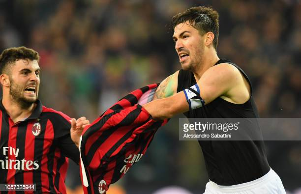 Alessio Romagnoli of AC Milan celebrates after scoring the opening goalduring the Serie A match between Udinese and AC Milan at Stadio Friuli on...