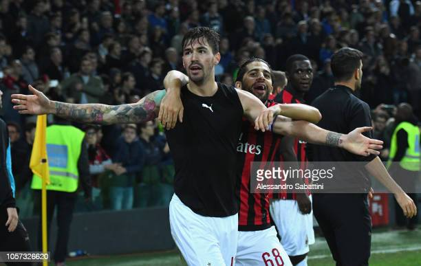 Alessio Romagnoli of AC Milan celebrates after scoring the opening goal during the Serie A match between Udinese and AC Milan at Stadio Friuli on...