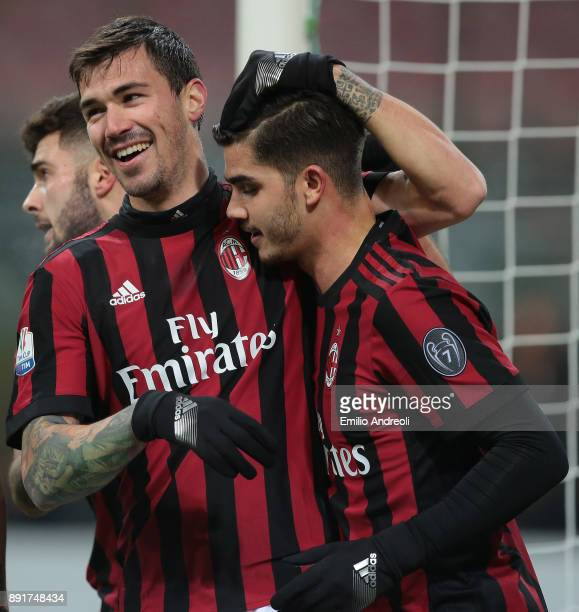 Alessio Romagnoli of AC Milan celebrates his goal with his teammate Andre Silva during the Tim Cup match between AC Milan and Hellas Verona FC at...