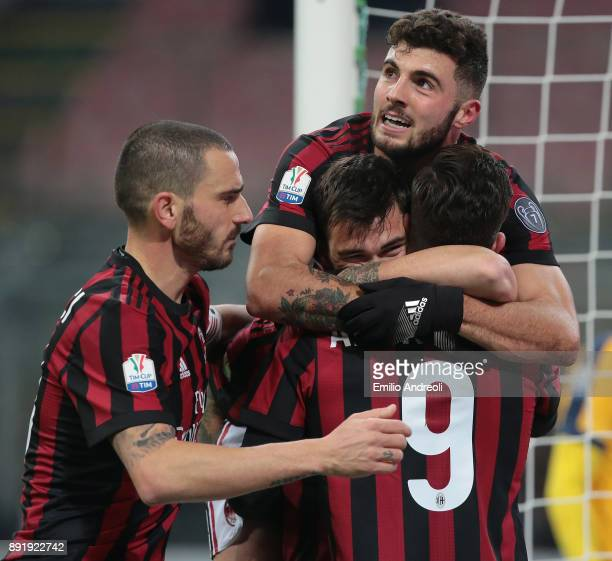 Alessio Romagnoli of AC Milan celebrates his goal with his teammate Patrick Cutrone Andre Silva and Leonardo Bonucci during the Tim Cup match between...