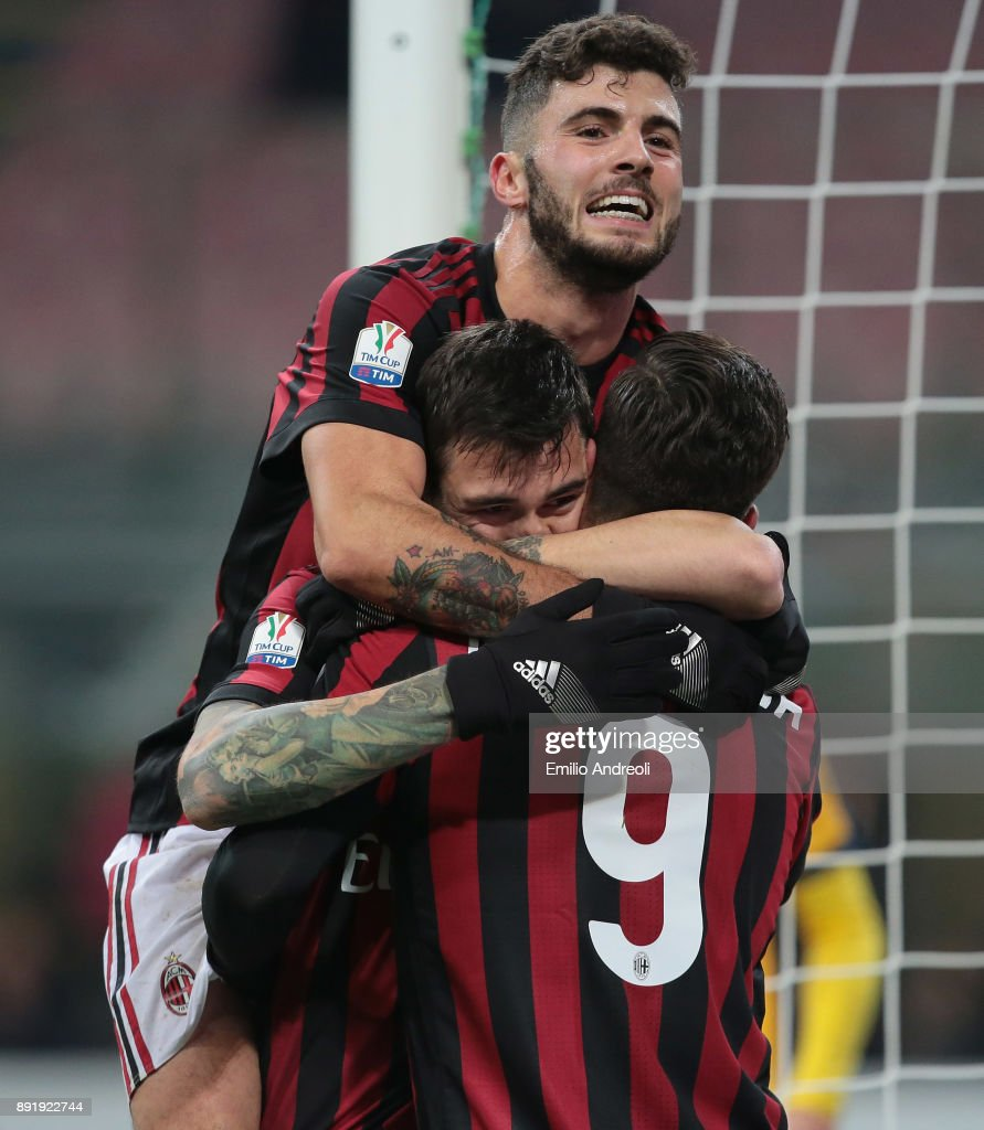 Alessio Romagnoli of AC Milan (C) celebrates his goal with his team-mate Patrick Cutrone and Andre Silva during the Tim Cup match between AC Milan and Hellas Verona FC at Stadio Giuseppe Meazza on December 13, 2017 in Milan, Italy.