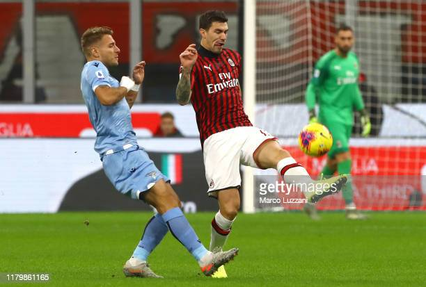 Alessio Romagnoli of AC Milan competes for the ball with Ciro Immobile of SS Lazio during the Serie A match between AC Milan and SS Lazio at Stadio...