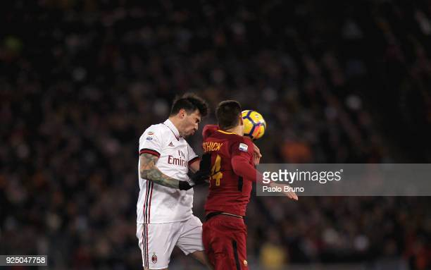 Alessio Romagnoli of AC Milan competes for the ball with Patik Schick of AS Roma during the serie A match between AS Roma and AC Milan at Stadio...