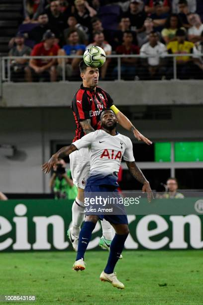 Alessio Romagnoli of AC Milan goes for a head ball in front of Georges-Kévin N'Koudou of the Tottenham Hotspur during the second half of the...
