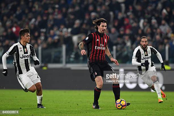 Alessio Romagnoli of AC Milan in action against Paulo Dybala of Juventus FC during the TIM Cup match between Juventus FC and AC Milan at Juventus...