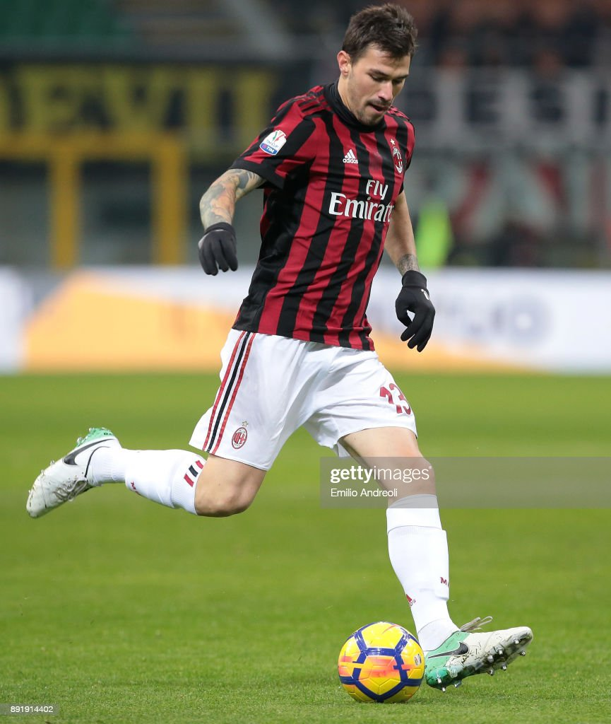 Alessio Romagnoli of AC Milan in action during the Tim Cup match between AC Milan and Hellas Verona FC at Stadio Giuseppe Meazza on December 13, 2017 in Milan, Italy.