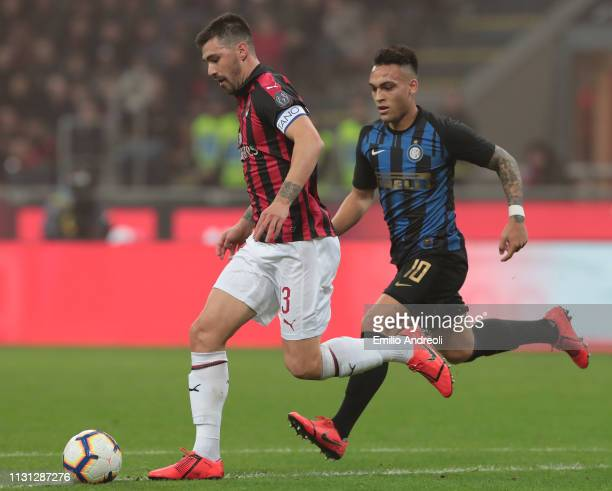 Alessio Romagnoli of AC Milan is challenged by Lautaro Martinez of FC Internazionale during the Serie A match between AC Milan and FC Internazionale...
