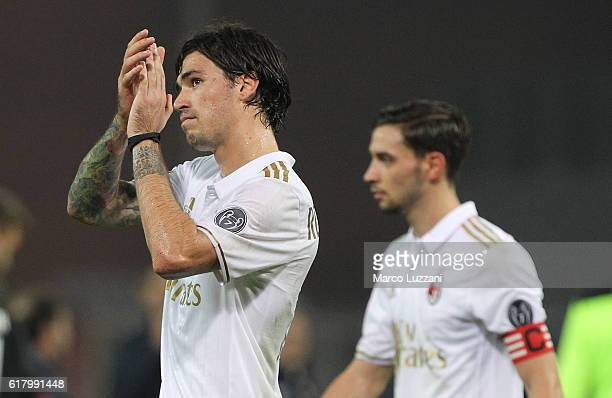 Alessio Romagnoli of AC Milan salutes the crowd at the end of the Serie A match between Genoa CFC and AC Milan at Stadio Luigi Ferraris on October 25...