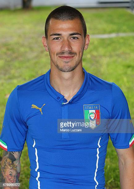 Alessio Romagnoli of Italy U21 poses with the shirt during the official Italy U21 portrait session at the training ground on June 13 2015 in Appiano...