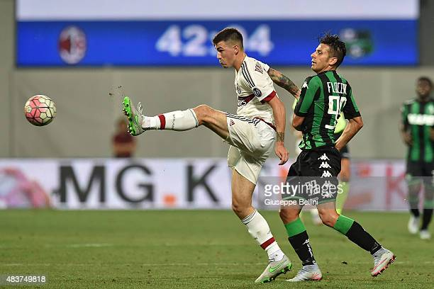Alessio Romagnoli of Milan and Sergio Floccari of Sassuolo in action during the TIM preseason tournament match between AC Milan and US Sassuolo...