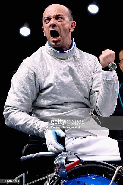 Alessio Sarri of Italy celebrates after winning the bronze in Men's Individual Sabre Wheelchair Fencing Category B on day 8 of the London 2012...