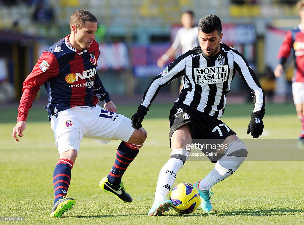 Alessio Sestu of Siena (R) and Diego Perez of Bologna in action during the Serie A match between Bologna FC and AC Siena at Stadio Renato Dall'Ara on February 10, 2013 in Bologna, Italy.