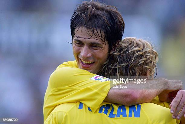 Alessio Tacchinardi and Diego Forlan of Villarreal celebrate a goal during the a Liga match between Villarreal and Mallorca played at the El Madrigal...