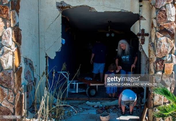 Alethea Densmore watches her grandkids as she tries to salvage belongings in her apartment with family members in Port St Joe beach Florida on...
