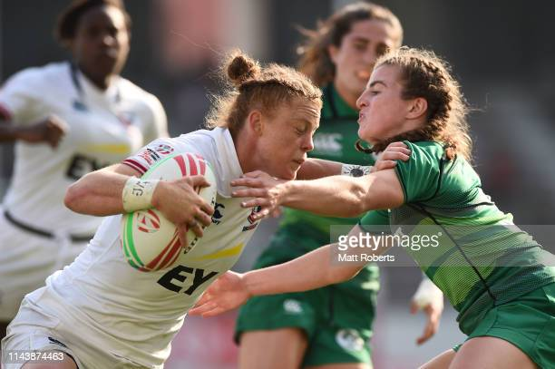 Alev Kelter of USA takes on the defence and scores a try during the pool match between USA and Ireland on day one of the HSBC Women's Rugby Sevens...