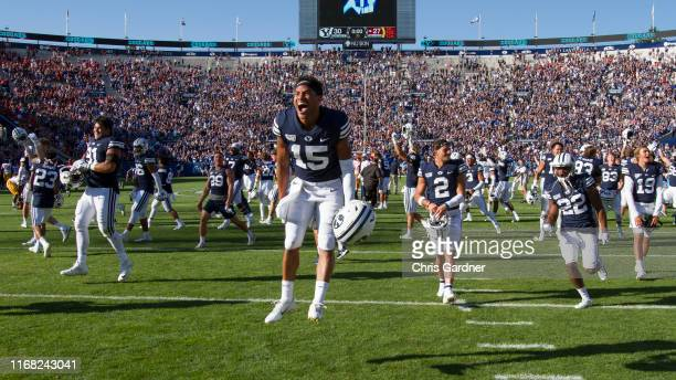 Aleva Hifo Earl TuiotiMariner Austin Lee and Dimitri Gallow of the BYU Cougars celebrate after their overtime win against the USC Trojans at LaVell...