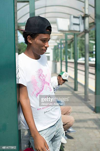 Alex a 28yearold from Ethiopia poses in an abandoned railway station waiting for the next train to arrive in an attempt to reach the Brenner Pass at...
