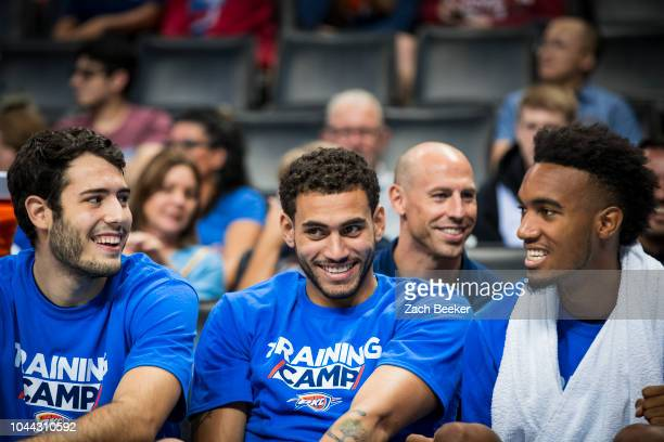 Alex Abrines Abdel Nader Terrance Ferguson of the Oklahoma City Thunder talk on the bench during an open practice on September 30 2018 at Chesepeake...