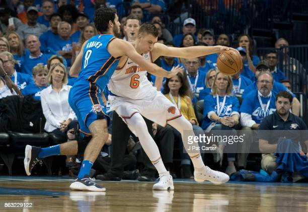 Alex Abrines of the Oklahoma City Thunder and Kristaps Porzingis of the New York Knicks battle for the ball during the first half of a NBA game at...