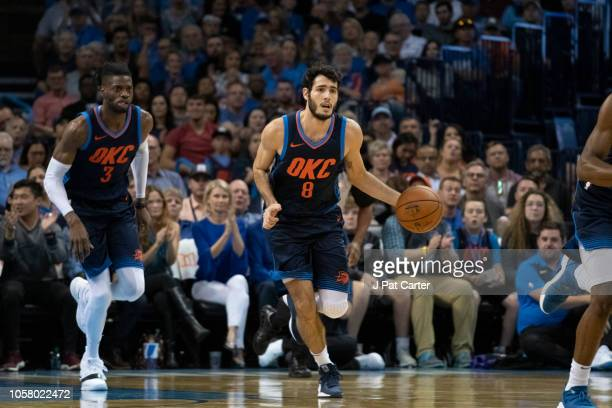 Alex Abrines of the Oklahoma City Thunder brings the ball up court against the Sacramento Kings during the first half of a NBA game at the Chesapeake...