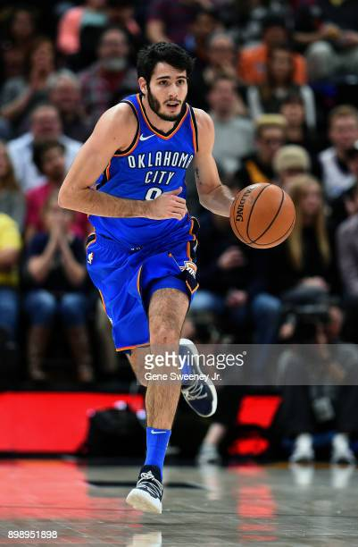 Alex Abrines of the Oklahoma City Thunder brings the ball up court during their game against the Utah Jazz at Vivint Smart Home Arena on December 23...