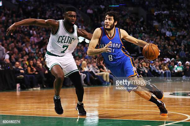Alex Abrines of the Oklahoma City Thunder drives against Jaylen Brown of the Boston Celtics during the first half at TD Garden on December 23 2016 in...