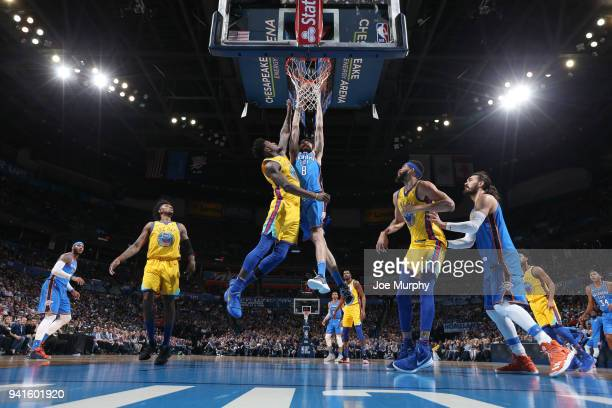 Alex Abrines of the Oklahoma City Thunder drives to the basket during the game against Jordan Bell of the Golden State Warriors on April 3 2018 at...