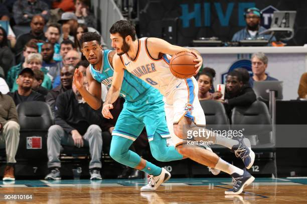 Alex Abrines of the Oklahoma City Thunder drives to the basket against Malik Monk of the Charlotte Hornets on January 13 2018 at Spectrum Center in...
