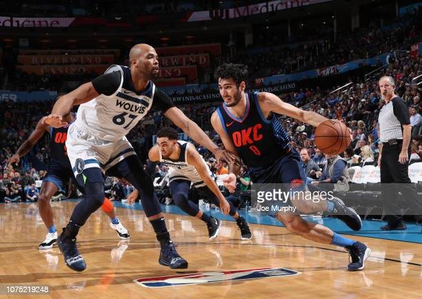 Alex Abrines of the Oklahoma City Thunder drives to the basket against Taj Gibson of the Minnesota Timberwolves on December 23, 2018 at Chesapeake...