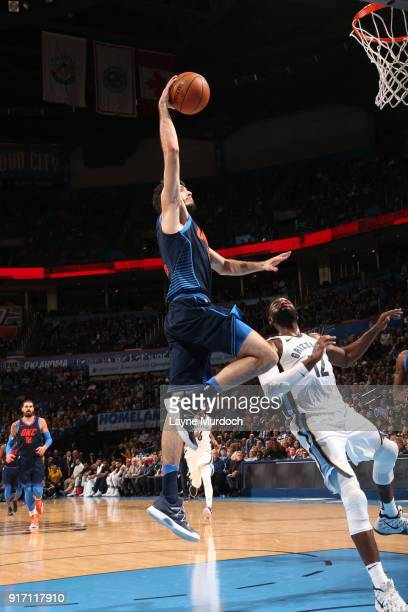 Alex Abrines of the Oklahoma City Thunder drives to the basket against the Memphis Grizzlies on February 11 2018 at Chesapeake Energy Arena in...