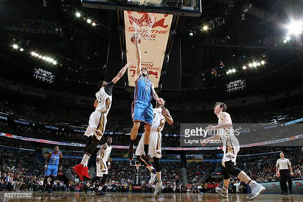 Alex Abrines of the Oklahoma City Thunder goes for the lay up during the game against the New Orleans Pelicans on January 25 2017 at the Smoothie...