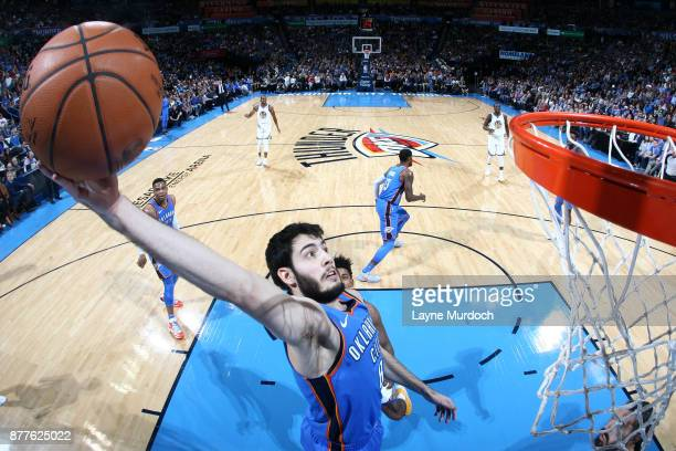 Alex Abrines of the Oklahoma City Thunder goes up for a dunk against the Golden State Warriors on November 22 2017 at Chesapeake Energy Arena in...