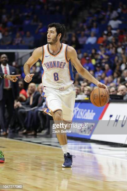 Alex Abrines of the Oklahoma City Thunder handles the ball against the Atlanta Hawks during a preseason game on October 7 2018 at BOK Center in Tulsa...