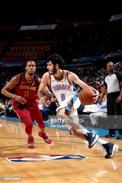 Alex Abrines of the Oklahoma City Thunder handles the ball against the Cleveland Cavaliers on November 28, 2018 at Chesapeake Energy Arena in...