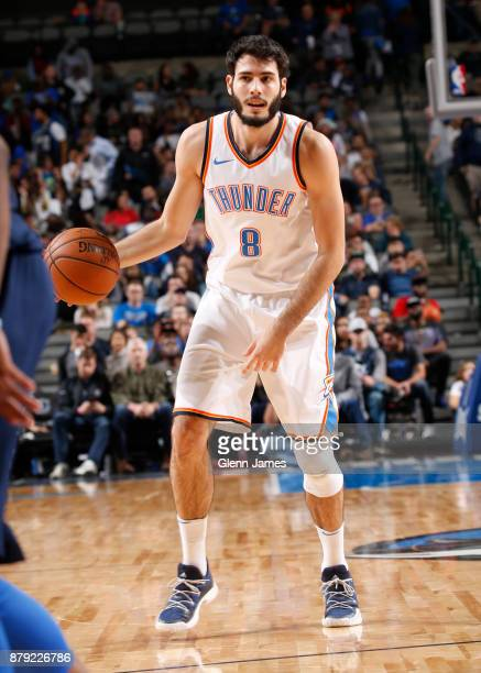 Alex Abrines of the Oklahoma City Thunder handles the ball against the Dallas Mavericks on November 25 2017 at the American Airlines Center in Dallas...