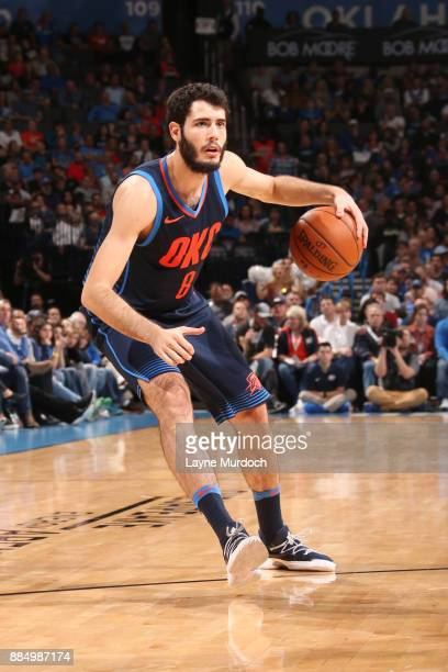 Alex Abrines of the Oklahoma City Thunder handles the ball against the San Antonio Spurs on December 3 2017 at Chesapeake Energy Arena in Oklahoma...