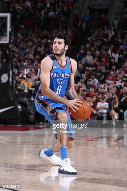 Alex Abrines of the Oklahoma City Thunder handles the ball against the Portland Trail Blazers on March 3 2018 at the Moda Center in Portland Oregon...