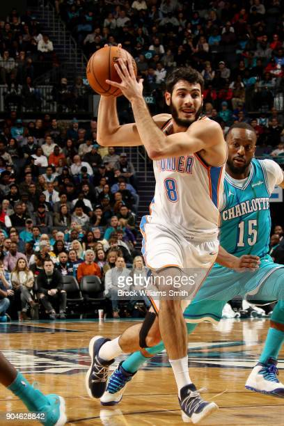 Alex Abrines of the Oklahoma City Thunder handles the ball during the game against the Charlotte Hornets on January 13, 2018 at Spectrum Center in...